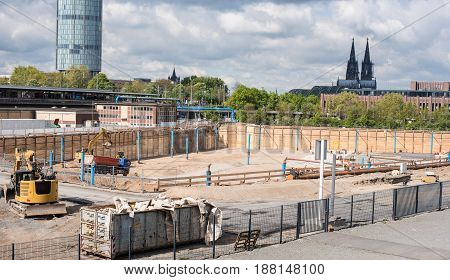 Large building site in front of Cologne Cathedral with high-rise building