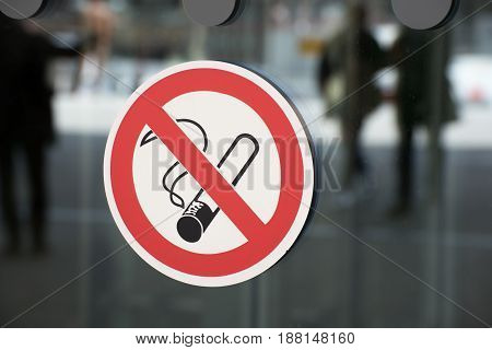 Non-smoking sign on a glass wall as a sign of prohibition