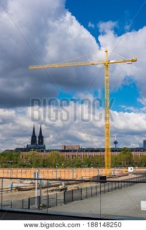 Construction crane on a large construction site in front of Cologne Cathedral