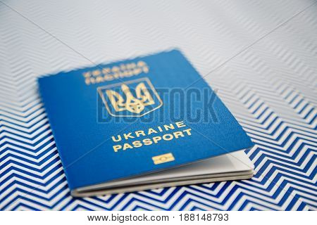 New Ukrainian Blue International Biometric Passport With Identification Chip On White And Blue Backg