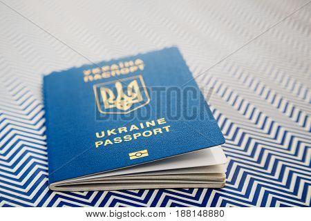 Close Up Of New Ukrainian Blue International Biometric Passport With Identification Chip On White An