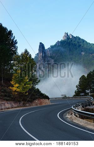Road near Riopar, Albacete, Spain, with fog in the autumnal landscape