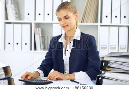 Modern business woman or confident female accountant in office. Student girl during exam preparing. Audit, tax service or education concept.