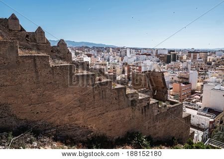 View from the fortress of Moorish houses and buildings along the port of Almeria Andalusia Spain