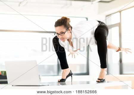 My tired arms. Low angle outgoing female looking at notebook computer while standing on tale. Work concept
