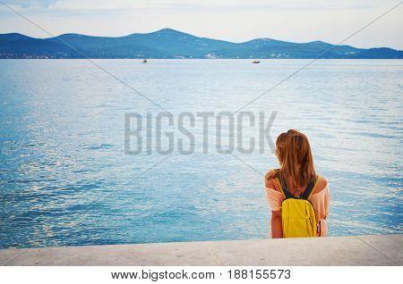One Young Girl With A Backpack Sitting Peacefully