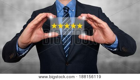 Businessman Holding Five Star Rating