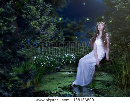 Beautiful girl in the fairy woods and a small lake