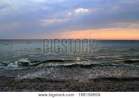 Sunset Landscape. Beautiful Cloud Sky,  Beach And Sea.