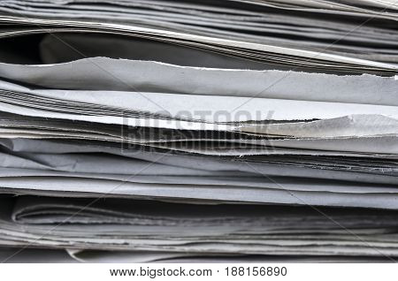 Macro shot of a pile of newspaper sheets