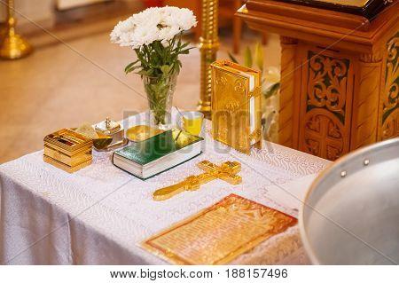 Golden religious utensils - Bible cross prayer book missal. Details in the Orthodox Christian Church. Russia.