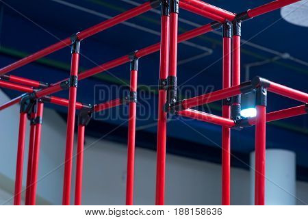 Industrial background - red plastic corrugated pipes modern