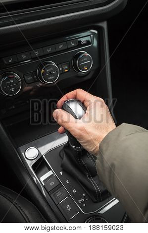 Drivers Hand Holds Gear Lever Of Crossover Car