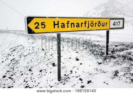 Yellow Icelandic Road Sign In Snowy Day