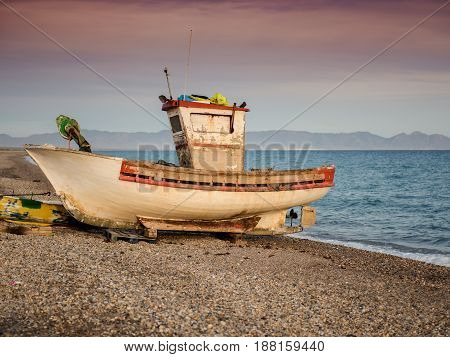 An old abandoned boat on the seashore