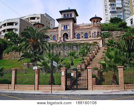 Torremolinos, Spain - September 18, 2016: Casa de los Navajas and garden on Bajondillo Embankment