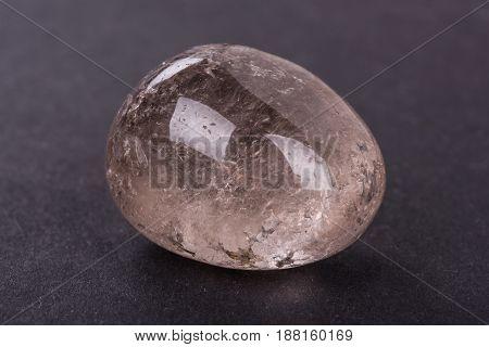 Topaz geode on black background. Beautiful natural crystal gemstone.