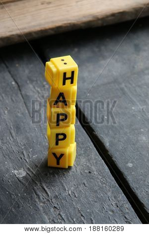 Word Happy on a vintage table, letter blocks