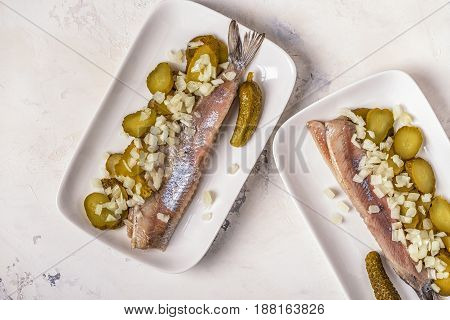 Traditional Dutch Raw Herring With Onions And Pickles.
