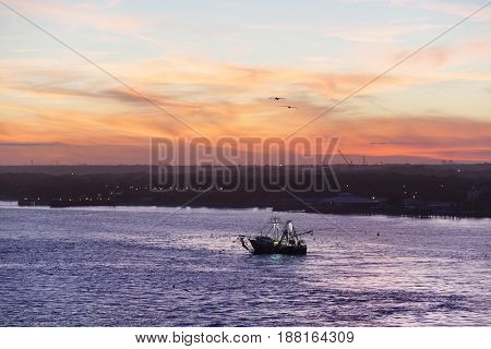 The fishing boat in Saint Johns River after the Sun went down (Jacksonville Florida).