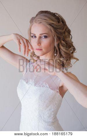 girl bride in a white dress wedding dress beautiful hands