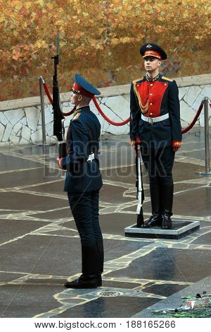 VOLGOGRAD, RUSSIA - MAY 3nd, 2017: Mamayev Hill War Memorial in Volgograd, Russia. Honour guard changing at memorial fire.