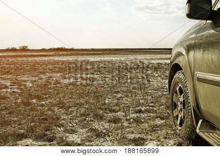 Truck car wheel on offroad deserted steppe adventure trail