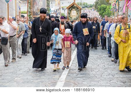 KIEV UKRAINE - JULY 27 2016 : Parishioners Ukrainian Orthodox Church Moscow Patriarchate during religious procession. At present there is undeclared war of Kiev Patriarchate and Moscow Patriarchate