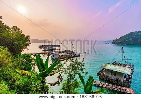 Scenic view of Sun Moon Lake with sunset and rafts