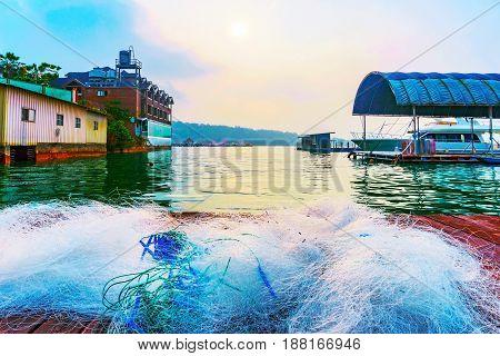 Fishing nets on a wooden raft on Sun Moon Lake