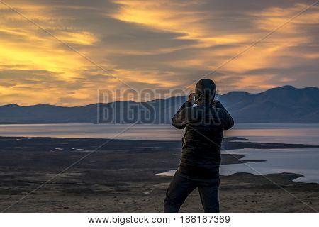Man Taking Photos At Sunset. Patagonia, Argentina