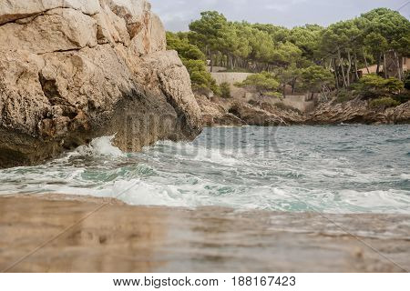 Water and wave on the coast of Mallorca