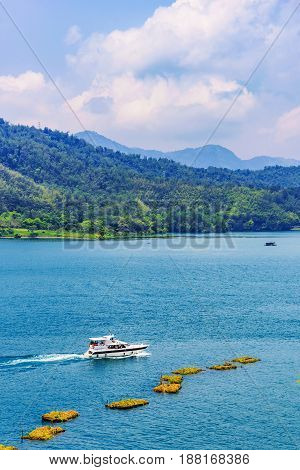 View of Sun Moon Lake nature and boat in Taiwan