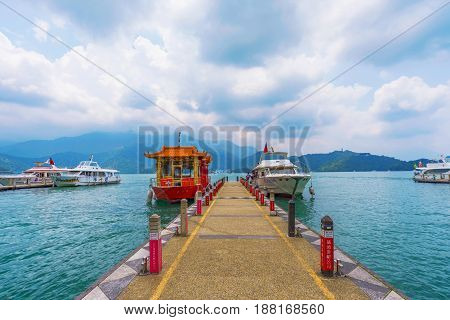 NANTOU TAIWAN - MAY 06: This is a pier on Sun Moon Lake with tour boats which tourists use to visit different sights on the lake on May 06 2017 in Nantou