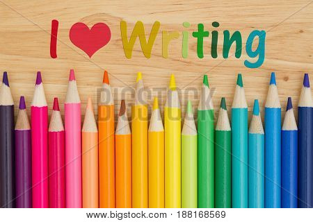 I love writing text with colorful pencil crayons on a desk