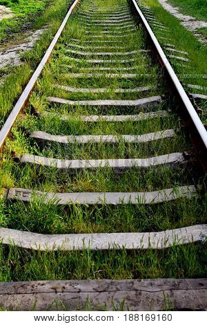 Rail road track on the green grass