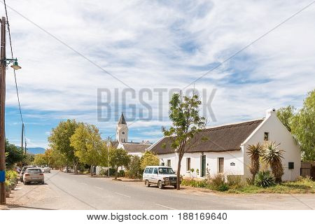 MCGREGOR SOUTH AFRICA - MARCH 26 2017: A street scene with historic buildings and steeple of the Dutch Reformed Church in McGregor a small town in the Western Cape Province