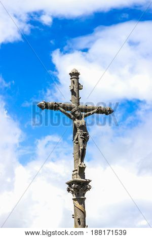 Crucifix on a blue sky background. The sanctuary of Lourdes, France