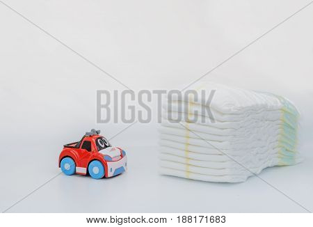 Baby Goods. Stack of Diapers. Toy car