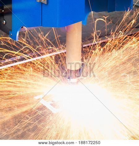 Cutting of metal. Sparks fly from laser