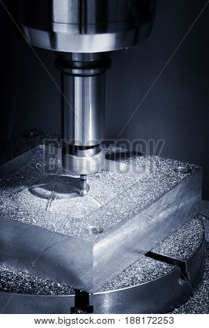 The Hi-precision CNC milling machine with cutting sample in blue-silver tone.The micro cutting technique in precision part.