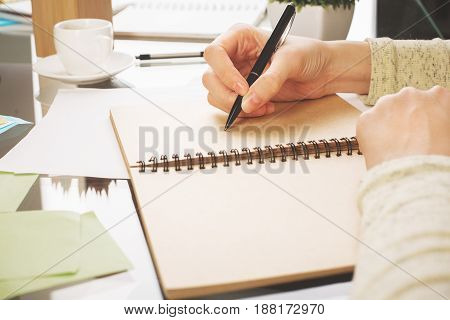 Woman Writing In Notepad Side