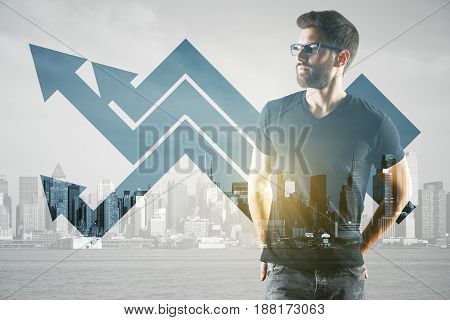Thoughtful young businessman on city background with upward chart arrows. Finance concept. Double exposure