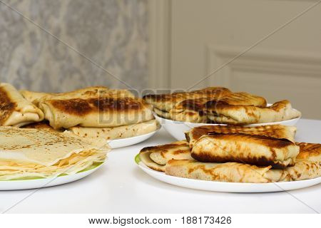 Fresh fried pancakes with a close-up filling