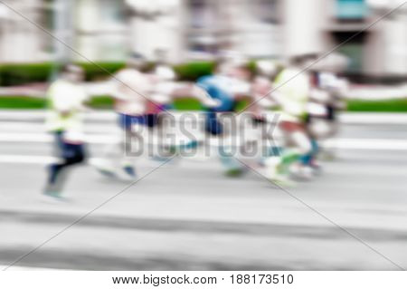 Group of young runners athlete running on the street, city marathon, blur effect, unrecognizable face. Sport, fitness and healthy lifestyle concept. For modern backdrop, place for your text