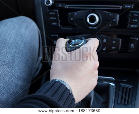 hand with manual gear shift lever close up