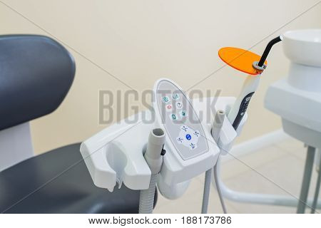 Dental UV curing light lamp . Ultraviolet polymerization lamp with Orange blocking glass. tooth care concept