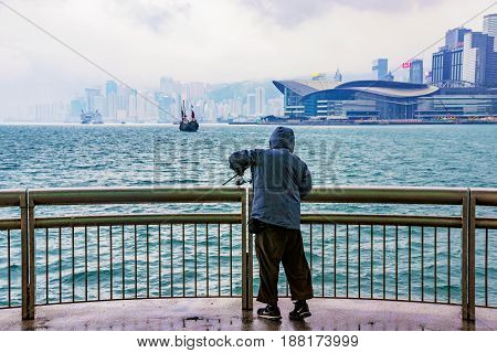 HONG KONG CHINA - APRIL 25: This is a fisherman trying to catch a fish during a storm in the downtown area of Hong Kong on April 25 2017 in Hong Kong