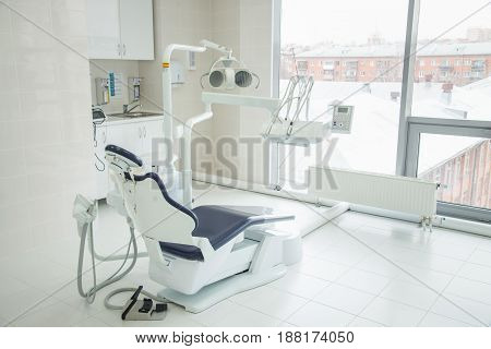 dental clinic interior with modern blue dentistry equipment.