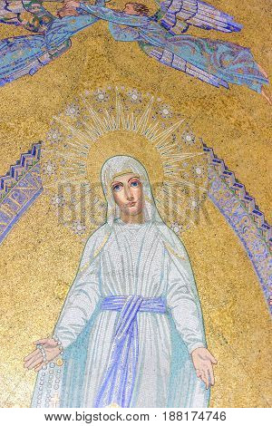 Virgin Mary. Beautiful mosaic in front of the Rosary Basilica. Lourdes, France